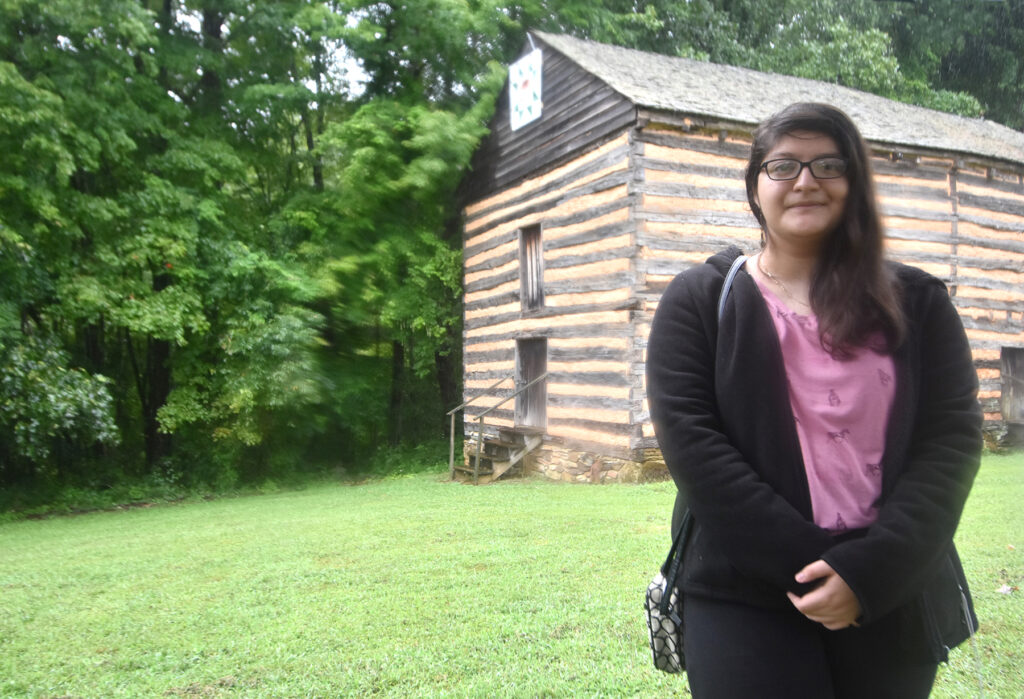 Second-year RCC student Hannia Adame-Riquelme, who is working toward her Associate Degree in Fine Arts, designed and painted a barn quilt square for RCC's Historical Village.