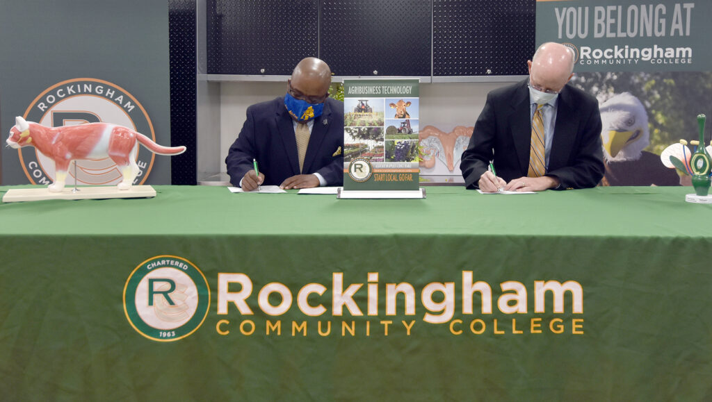 RCC and NC A&T sign an agreement so students can finish a two-year Agribusiness Technology degree at RCC and transfer to A&T to finish a four-year degree.