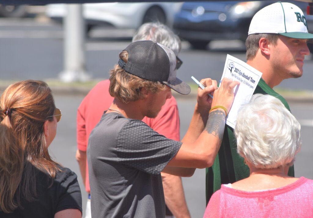 Baseball player signs an autograph
