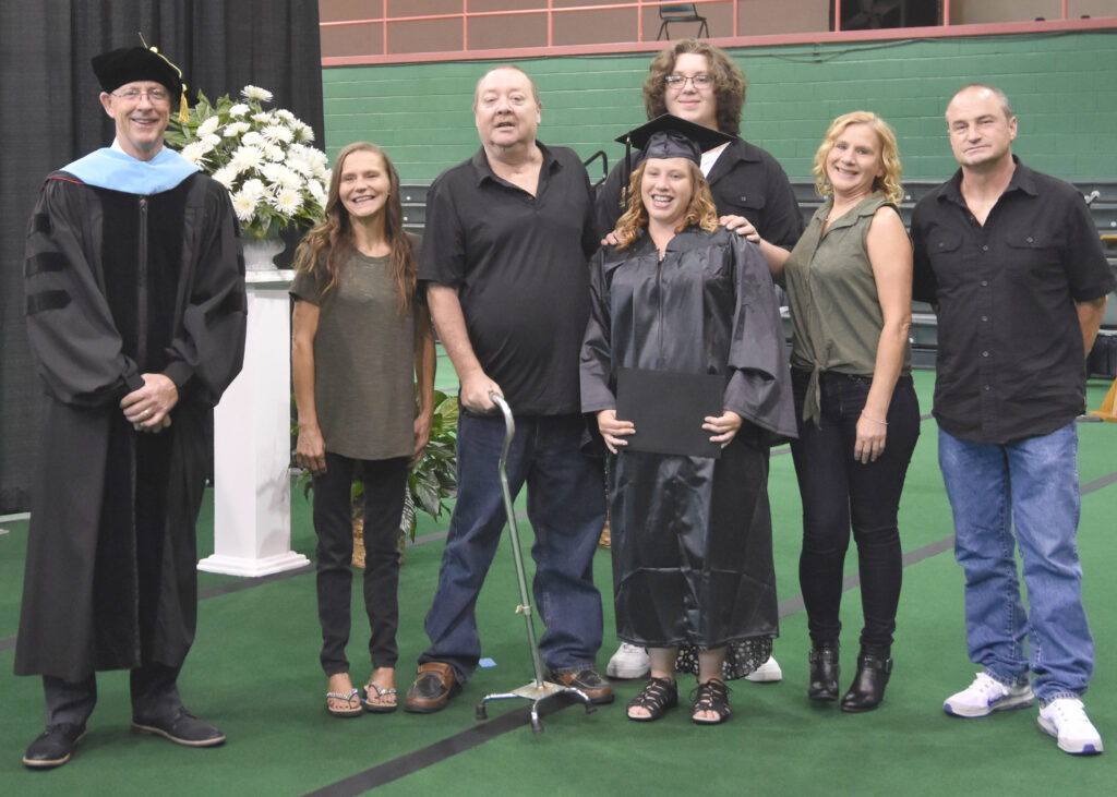 Dr. Mark Kinlaw with a graduate and her family
