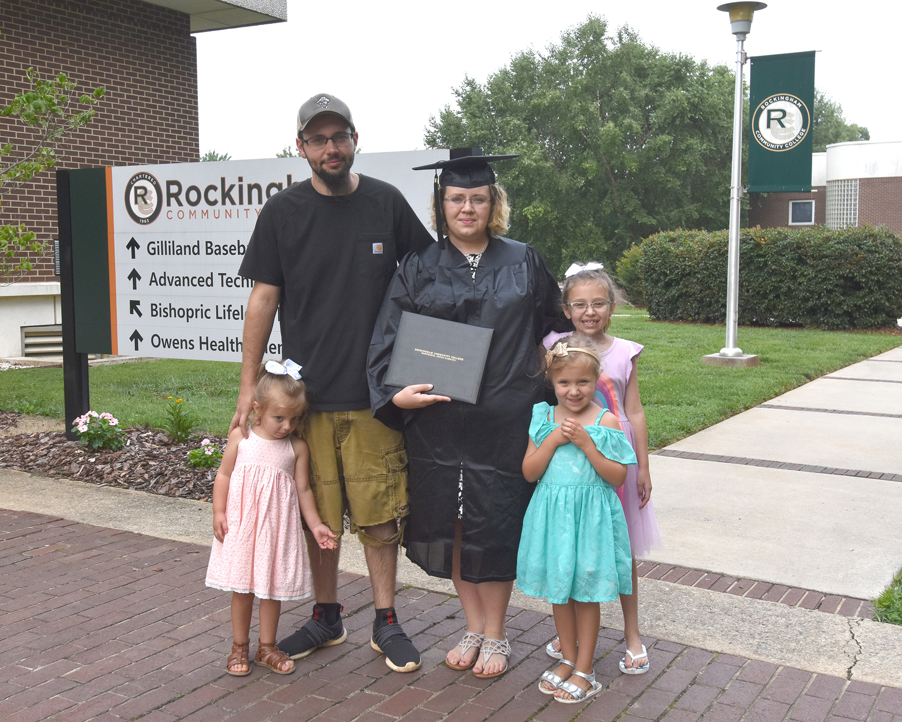 Graduate with family members