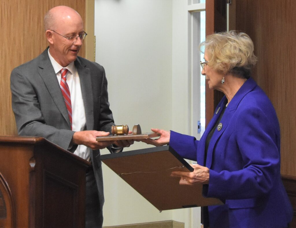 RCC President Dr. Mark Kinlaw presents a gavel and plaque to outgoing Board of Trustees Chair Janice Tate on July 20, 2021.