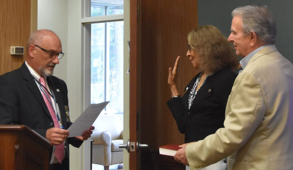 Randy Judkins and Nelson Cole take their oaths of office for the RCC Board of Trustees.