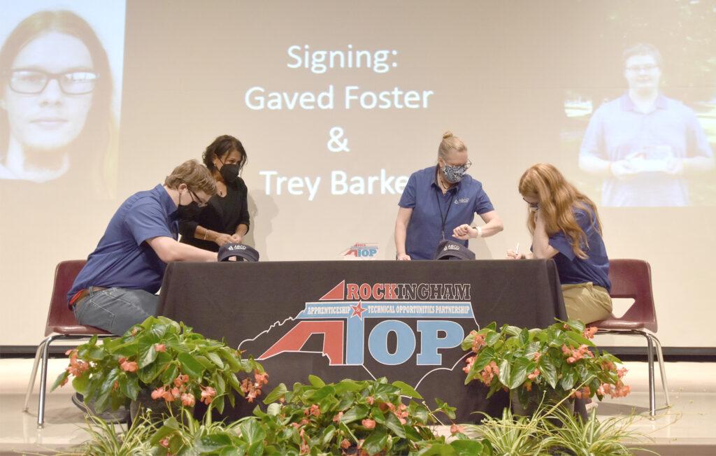 Apprentices sign RockATOP agreements.